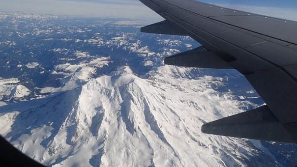 airplane over Mt Rainier