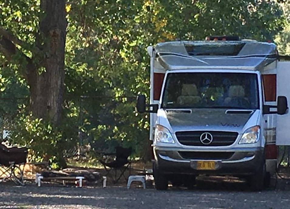 RV at wooded campsite