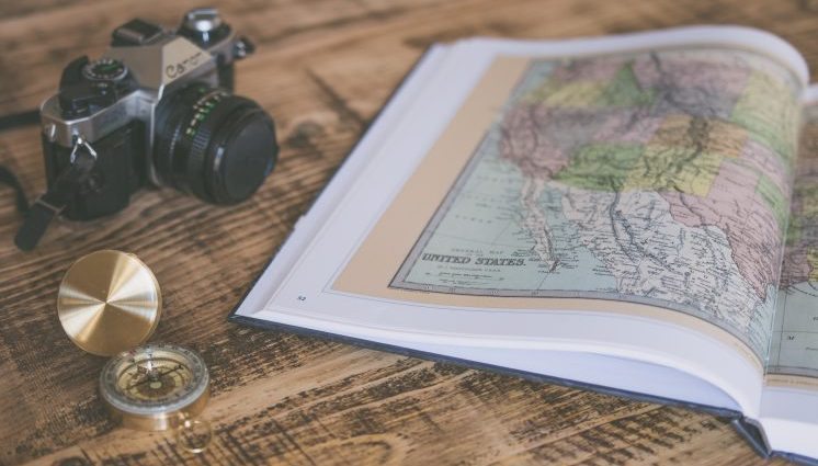 US map with camera and compass