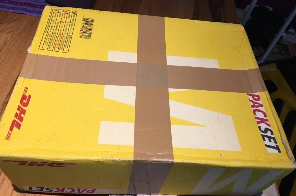yellow DHL package unopened