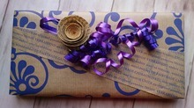 gift-wrapped box with purple string