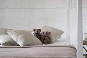 stuffed bears on bed