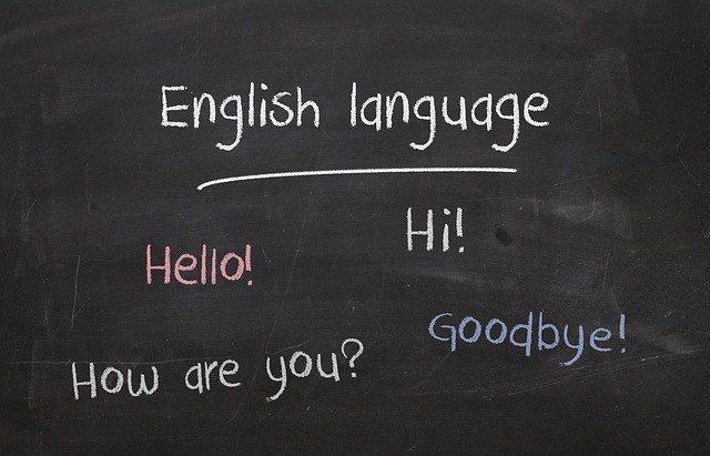 English words on chalk board hello hi how are you goodbye