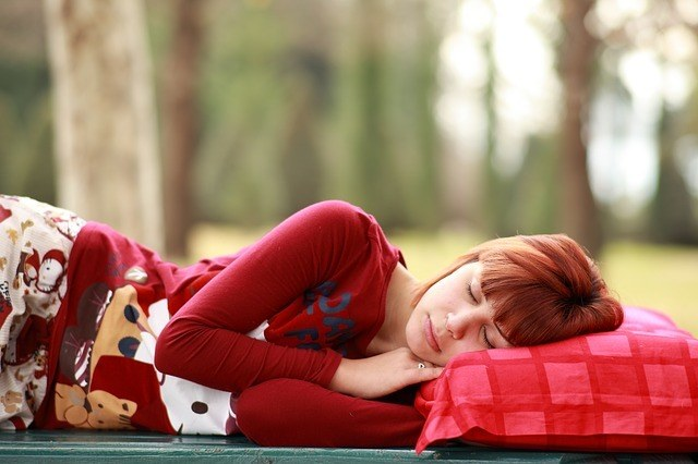 young woman sleeping outside