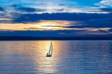 sailboat at sunset blue colors