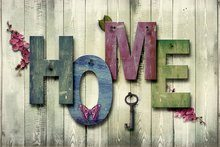 word home on wood plank background