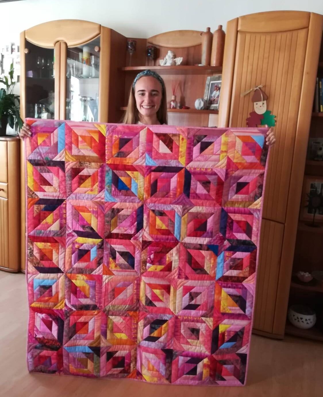girl holding homemade quilt